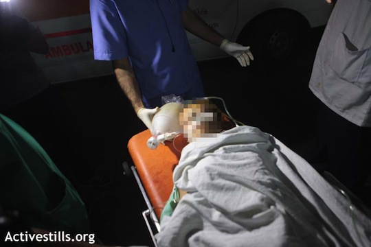 Palestinian child being treated at Shifa Hospital for injuries following Israeli strike on Gaza (photo: Anne Paq / Activestills)