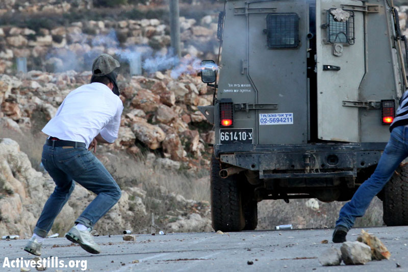 Mustafa Tamimi, a 28 year-old Palestinian from Nabi Saleh, is seen seconds before he gets hit with a tear gas canister shot by an Israeli soldier from a short distance during the weekly demonstration in the West Bank village of Nabi Saleh, December 9, 2011. (Haim Scwarczenberg/Activestills guest photographer)