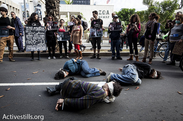 Israeli activists take part in a performance illustrating Palestinian detainees during the annual human rights march, Tel Aviv, Israel. (photo: Shachaf Polakow/Activestills)