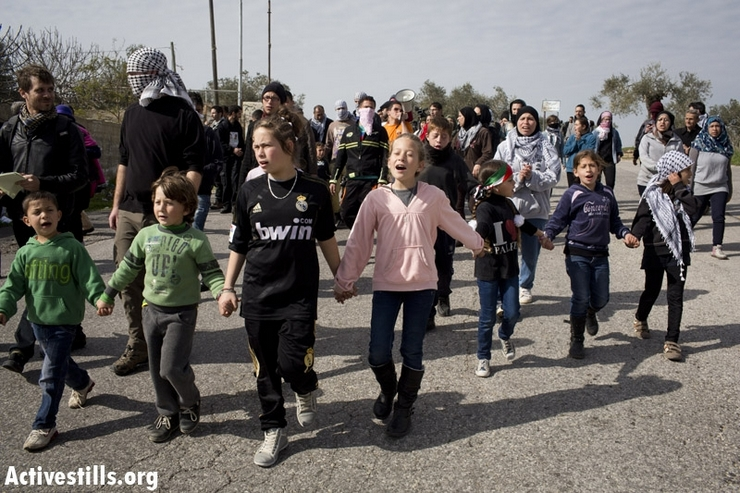 Palestinian children march during the weekly demonstration in the village of Nabi Saleh, West Bank, January 25, 2013.  (Photo by: Oren Ziv/Activestills.org)