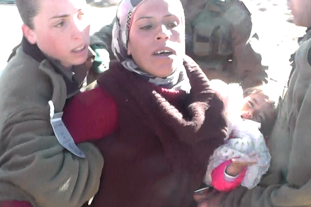 Palestinian resident of West Bank being arrested with her 1.5 year old child (Ta'ayush activist)