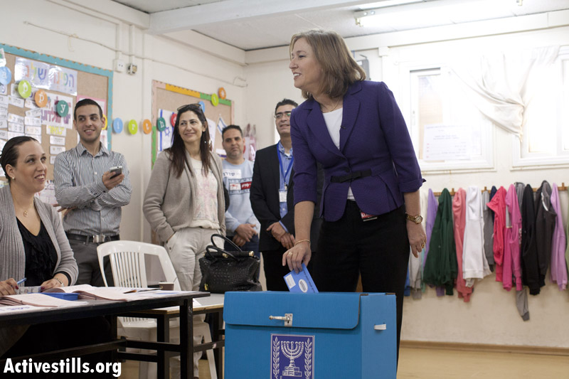 'Zionist Camp' leader Tzipi Livni votes in the 2013 Knesset elections. (photo: Yotam Ronen/Activestills)