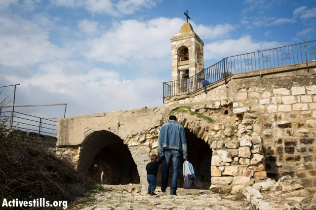 Church of Our Lady in Bir'em. Believers removed grafiti from its walls (Oren Ziv / Activestills)
