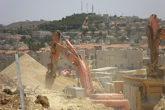 Bulldozers in the Gush Etzion settlement bloc. (flickr / ☪yrl CC BY-NC 2.0)
