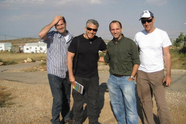 Yair Lapid (second from the left) and Naftali Bennett (to his left) at the West Bank outpost Kida. A new alliance between the settlers and the Israeli center. (photo: Yesha Council)