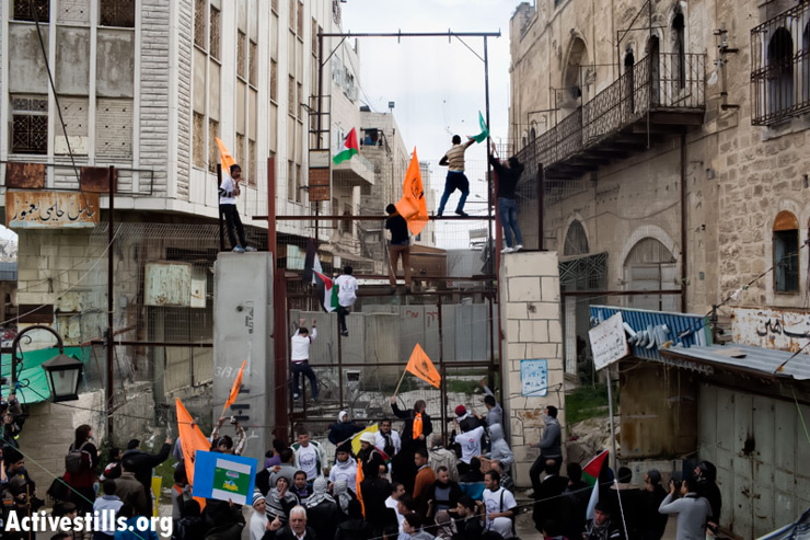 From Hebron's streets to Ofer's walls: A week in photos - February 21-27