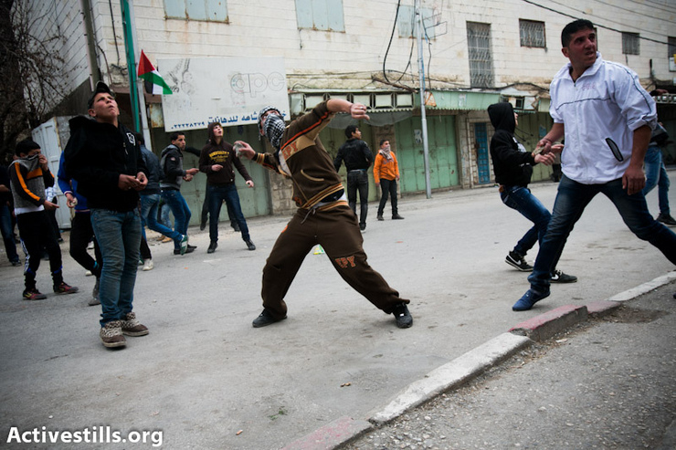 Demonstrators clash with the Israeli army during a protest against the continued closure of Shuhada street to Palestinians, in the West Bank city of Hebron February 22, 2013. (Photo by: Yotam Ronen/Activestills.org)