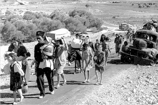 Palestinian refugees 'making their way from Galilee in October-November 1948' (Fred Csasznik, copyright expired)