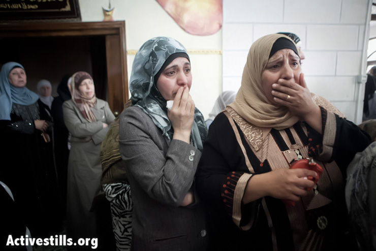 Relatives of Muayad Nazih Ghazawneh mourn during his funeral in the West Bank city of Al-Ram, March 15, 2013. Ghazawneh died after Israeli forces fired tear-gas canisters directly into his car during clashes in Al-Ram three weeks ago. He remained in a state of coma until he succumbed to his wounds on March 15, 2013. (Photo by: Shiraz Grinbaum/Activestills.org)