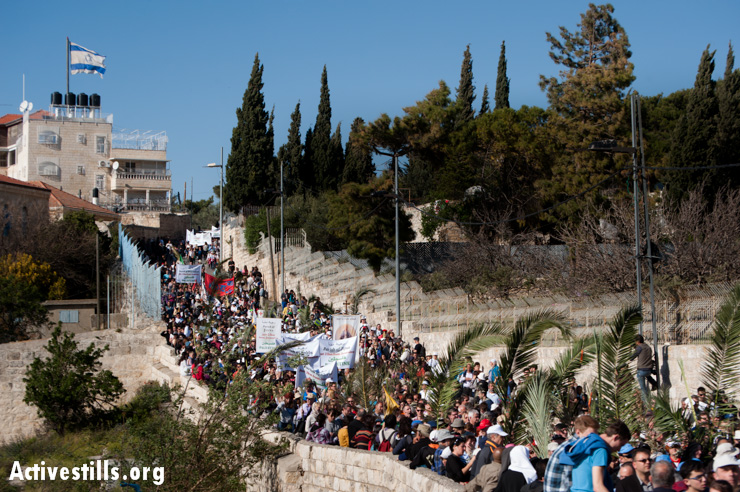 Palestinian and international Christian pilgrims march past an Israeli settlement on the Mount of Olives in East Jerusalem. All Israeli settlements in the occupied Palestinian territories, including East Jerusalem, are illegal under international law.
