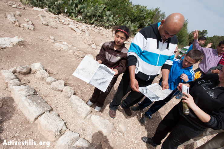 Palestinian citizens of Israel find a grave marker pictured in a guide book published by the activist group Zochrot, whose primary mission is to educate Jewish Israelis about the history of the Nakba.