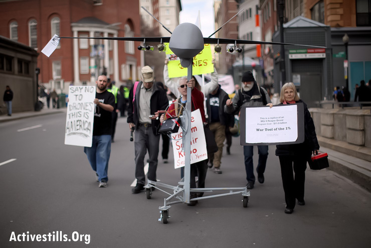 "Activists protest the use of drones by American armed forces, April 13, 2013 in downtown Boston, MA. The protest came as part of the ""April Days of Action"", a national campaign of counter-drone protests. (Photo: Tess Scheflan/Activestills.org)"