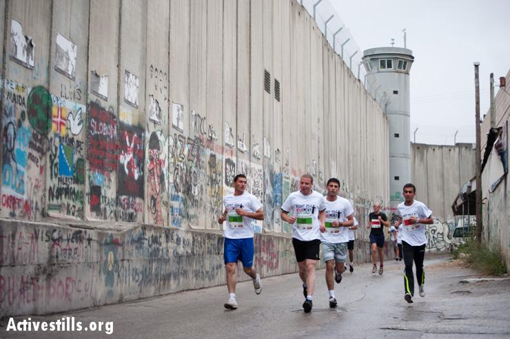PHOTOS: First Palestine Marathon runs between walls in Bethlehem