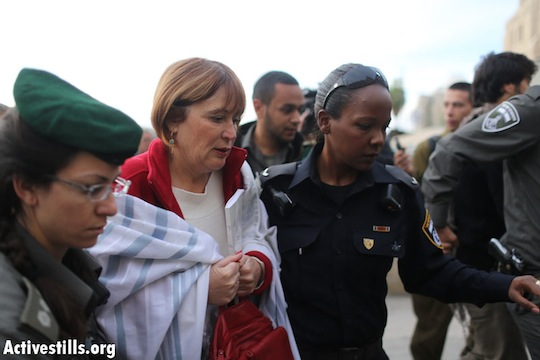 A member of 'Women of the Wall' is arrested for wearing a Talit at the Western Wall. April 11, 2013 (Oren Ziv/Activestills.org)