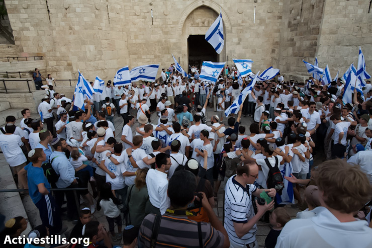 Israeli settlers march into the Old City of Jerusalem during the 'Jerusalem Day' march, East Jerusalem, May 8, 2013. Earlier that day, police forces ordered Palestinian shops and stands inside the Old City to close at 15:00. In previous years, Israeli settlers had vandalized and destroyed many Palestinian shops that remained open during the march. (Photo by: Yotam Ronen/ Activestills.org)