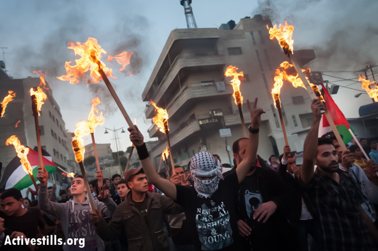 Palestinians march with torches through the streets of Bethlehem to commemorate the Nakba, May 14, 2013. (Photo by: Ryan Rodrick Beiler/Activestills.org)