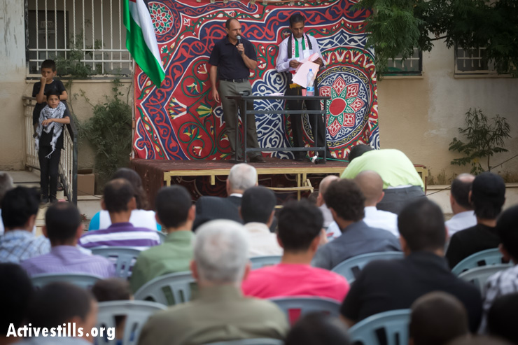 Ayed Morrar, leader of the Popular Committee in Budrus, addresses the crowd, emphasizing women's role in the unarmed popular struggle and the importance of unity across political lines.