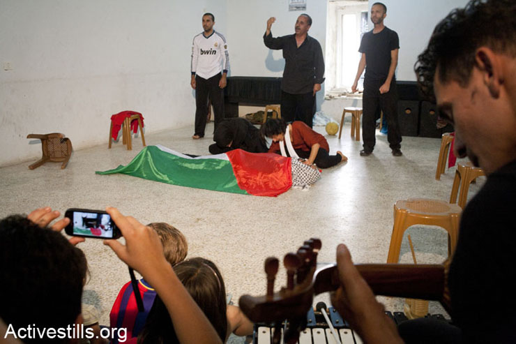 A scene portraying the death of Mustafa Tamimi. Mustafa was shot in the face at close range with a tear gas canister by Israeli soldiers on December 9, 2011.