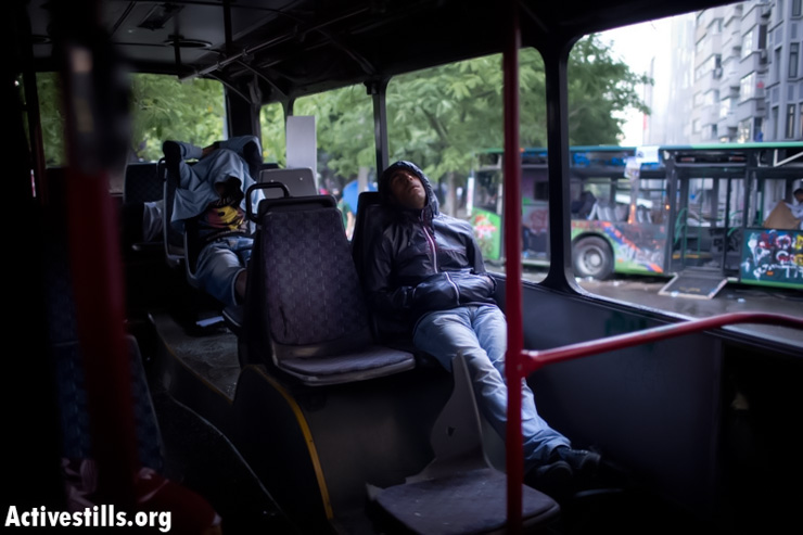 Protesters sleep in a damaged bus in Taksim Square, early June 5, 2013. (Photo by: Oren Ziv/ Actviestills.org)