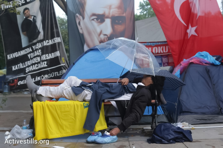 A man sleeps after a rainy night in Gezi park, Istanbul, Early June 15, 2013.(Photo by: Oren Ziv/Activestills.org)