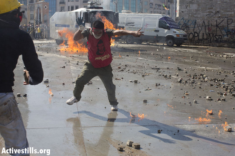 PHOTOS: Turkish police take over Taksim Square, push back protesters