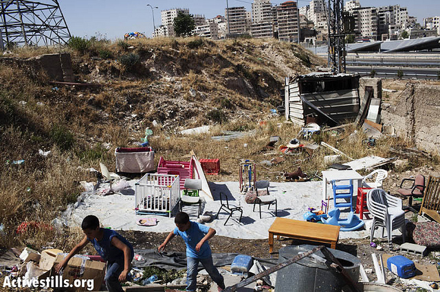 The State of Israel demolished the Sabah family house and left two parents and five children homeless, Shuafat Refugee Camp, May 20 2013. (photo: Tali Maier/Activestills)