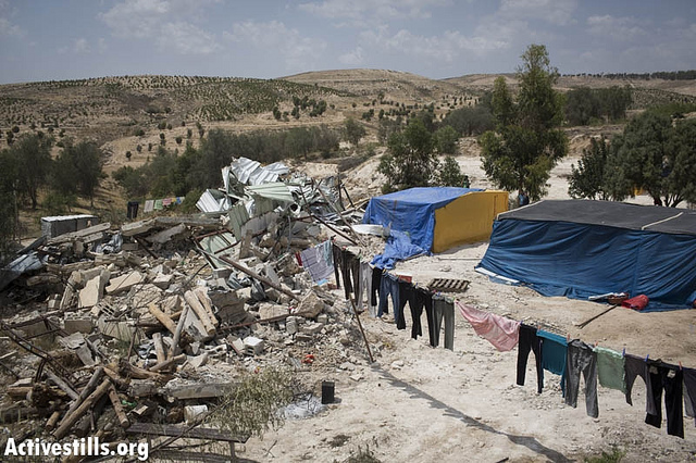 The State of Israel demolished 15 structures and left tens of Bedouins homeless in the unrecognized Bedouin village of Atir, Negev (within the 67 borders), Mat 21 2013. (photo: Oren Ziv/Activestills)
