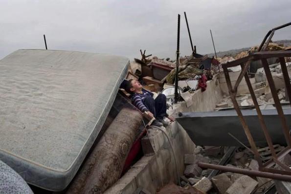 The State of Israel demolished two houses and left 30 people homeless, Feb. 5 2013, Beit Hanina, East Jerusalem. (photo: WAFA)