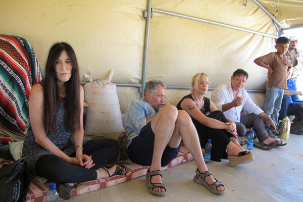 June 26, 2013 – Writers Zeruya Shalev, Eyal Megged and Alona Kimhi and attorney Shlomo Lecker (from left to right) speak in the village of Mufaqara, south of Hebron, about Palestinians living within Firing Zone 918, who face possible military eviction. (photo: Matt Surrusco, +972 Magazine)