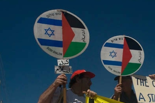 Israeli and Palestinian flags in a peace march. 74 percent of Palestinians fear that they will be hurt by an Israeli (Activestills.org)