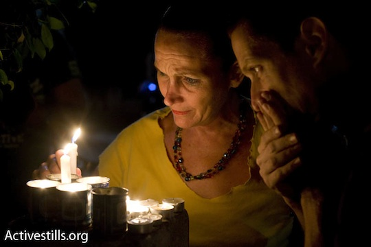 Israelis hold a candle-light vigil outside the BarNoar LGBTQ youth center in Tel Aviv after the 2009 shooting that left two dead and 11 injured, August 2, 2009 (Photo: Activestills.org)