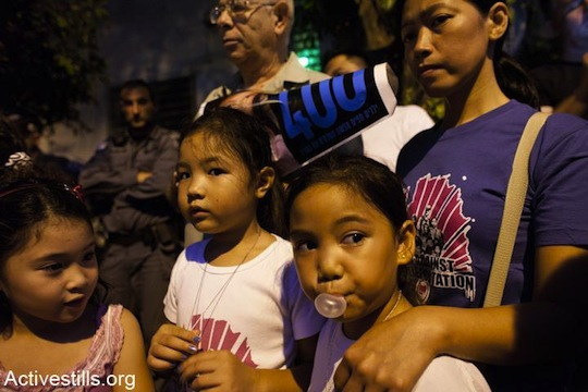 Filipino migrant workers participate in a protest against deportations, Tel Aviv. (photo: Activestills)