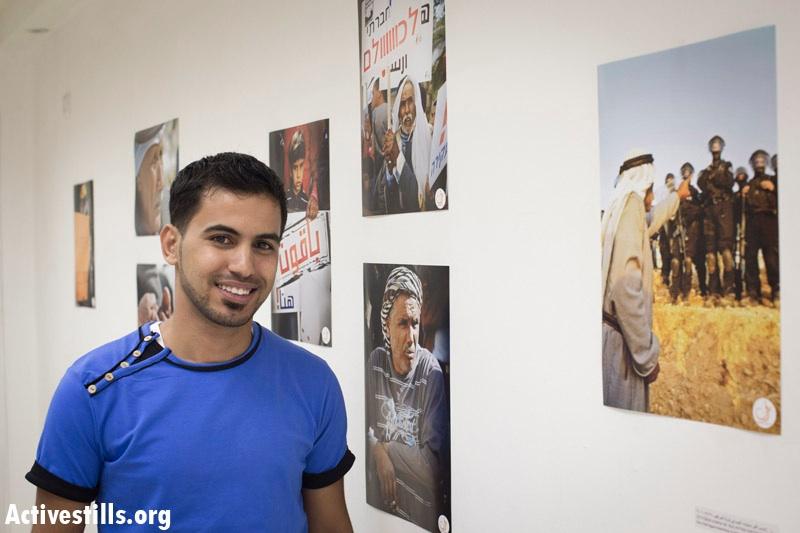 "Photographer Aiob Abo Madegam at his photo exhibition in Tel Aviv, ""Baqon,"" July 28, 2013 (Photo: Oren Ziv/Activestills.org)"