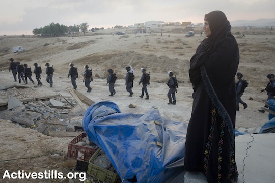 A Bedouin woman looks over her the ruins of her home after Israeli forces demolished the Negev village of Al Araqib, September 12, 2010. (Oren Ziv/Activestills)