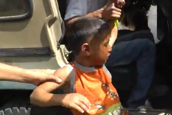 Five-year-old Palestinian boy being detained in Hebron. (Screenshot)