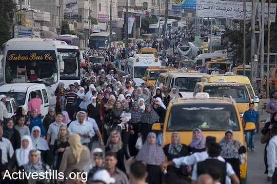 Palestinians arrive to Qalandiya checkpoint outside Ramallah, West Bank, to cross into Jerusalem to attend the Ramadan Friday Prayers in Al-Aqsa Mosque, July 19, 2013. (Photo: Nidal Elwan/ Activestills.org)