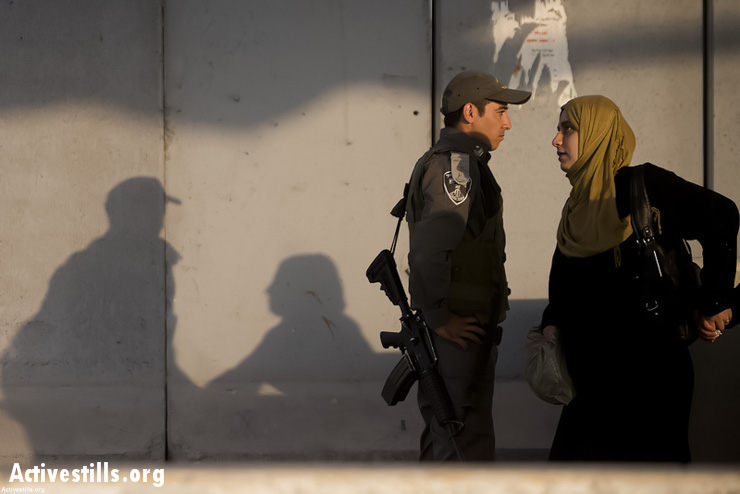 Palestinian women cross the Qalandiya checkpoint outside Ramallah, West Bank, into Jerusalem to attend the first Friday of Ramadan prayers in the Al-Aqsa Mosque, July 12, 2013. (Activestills.org)