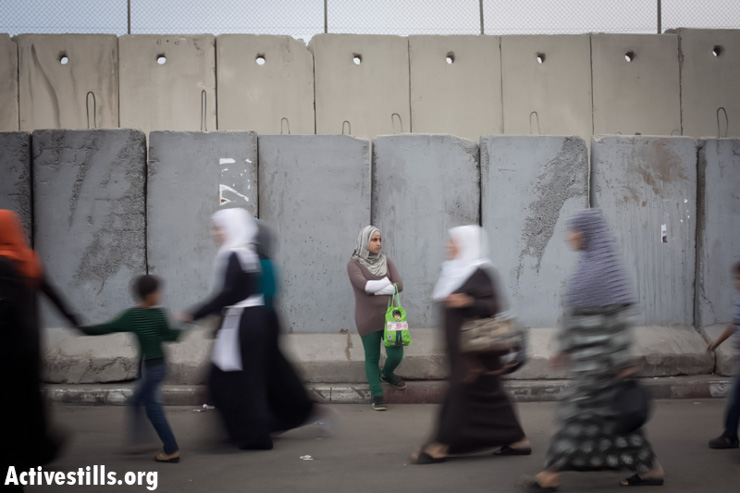 Palestinian women cross the Qalandiya checkpoint outside Ramallah, West Bank, into Jerusalem to attend the first Friday of Ramadan in the Al-Aqsa Mosque, July 12, 2013. (Photo by: Oren Ziv/ Activestills.org)