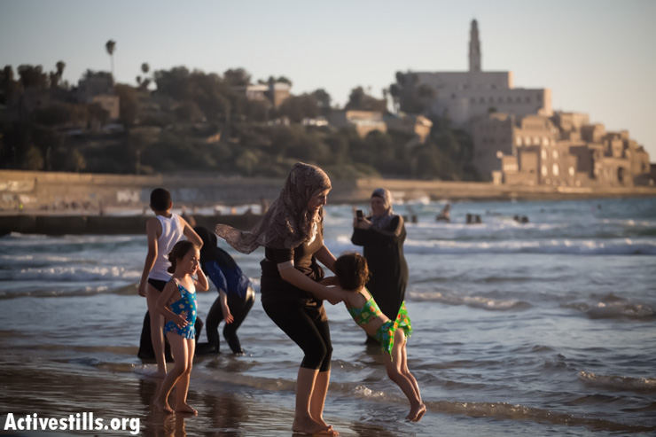 Palestinians enjoy a day at a beach during Eid al-Fitr, which marks the end of the holy month of Ramadan August 8, 2013, in Jaffa.