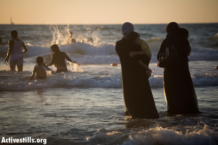 Palestinians enjoy a day at a beach during Eid al-Fitr, which marks the end of the holy month of Ramadan August 8, 2013, in Jaffa. Hundreds of thousands of Palestinians from the occupied West Bank entered Israel since the beginning of Ramadan, without significant incident.