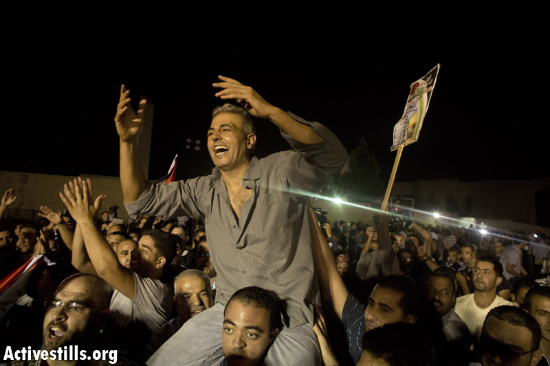PHOTOS: Released Palestinian prisoners arrive home to West Bank