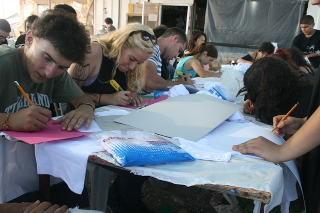 Working together on colorful Iqrit T-shirts (Haggai Matar)