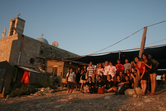 The two summer camps outside the Iqrit church at sunset (Haggai Matar)
