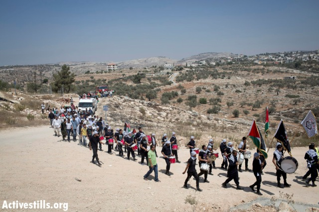 The march from the village goes over the old route of the wall (Oren Ziv / Activestills)