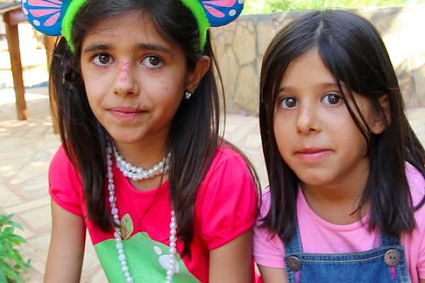 Amneh (11) and Arwa (8) participate in the Syrian refugee educational camp. (photo: Aziz Abu Sarah)