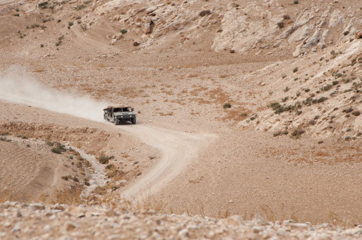 An Israeli military humvee patrols the South Hebron Hills near the village of Khirbet at Tabban. (photo: Ryan Rodrick Beiler/Activestills.org)