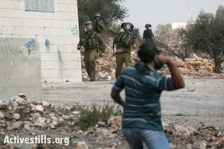 Demonstrators clash with Israeli soldiers during the weekly demonstration against the occupation in the West Bank village of Kafr Qaddum, on September 27, 2012. (photo: Yotam Ronen/Activestills.org)