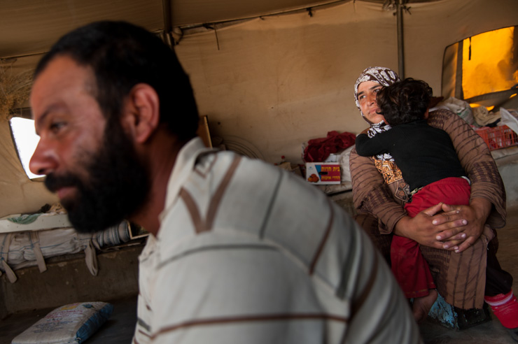 The Abu Sab'aa family of Khirbet al Fakheit sits in their tent. (photo: Ryan Rodrick Beiler/Activestills.org)