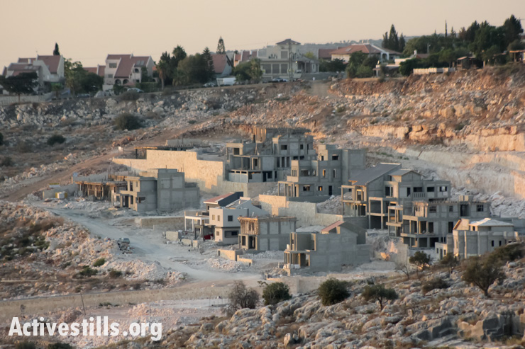 A view of construction of new housing units in the settlement of Beit Arye on the lands of the West Bank village of Abud, near Ramallah, September 13, 2013. (photo: Ahmad Al-Bazz/Activestills.org)