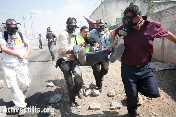 A journalist is injured during the weekly demonstration against the occupation in the West Bank village of Kafr Qaddum, on September 27, 2012. (photo: Yotam Ronen/Activestills.org)